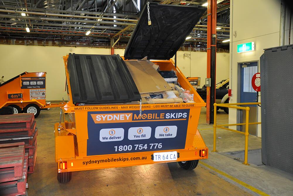 Lid open on mini skip bin. Sydney Mobile Skips.