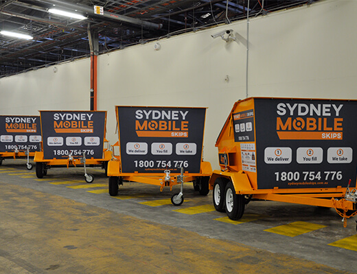 4 mobile skip bins in Sydney warehouse. Sydney Mobile Skips.