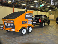 Mini skip bin on trailer towed by 4x4. Sydney Mobile Skips.